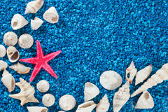 Star-fish and seashells on sand Royalty Free Stock Photography