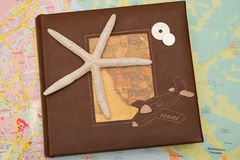 Star fish on travel book. With map background Stock Images