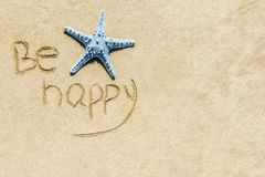 Star fish on white sand, beach background Royalty Free Stock Image