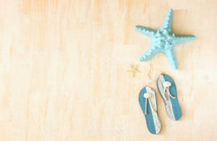 Star fish and wooden flip flops decoration Stock Photos