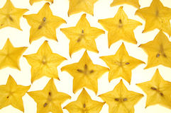 Star fruit. Many pieces of sliced starfruit on a white background royalty free stock photos