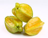 Star fruit. Three ripening star fruits on white background Royalty Free Stock Photography