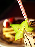 Star fruit on a chocolate milkshake, carambola Royalty Free Stock Photography