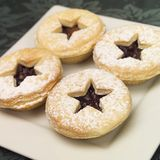 Star fruit mince pies. A plate of fruit mince pies Royalty Free Stock Photography