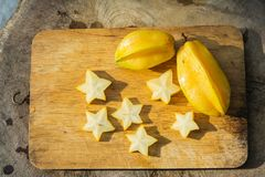 Star fruit. On old wood background Stock Photography