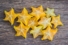 Star fruits on wooden table. Thai fruit : Star fruit is popular. In asia, sweet taste fruits. Star fruits sliced on wood background. Selective focus Royalty Free Stock Photography