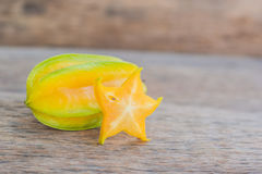 Star fruits on wooden table. Thai fruit : Star fruit is popular. In asia, sweet taste fruits. Star fruits sliced on wood background. Selective focus Royalty Free Stock Image