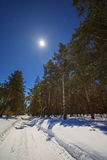 The Star and the full moon in the sky at night. Winter road with Stock Photo