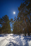 The Star and the full moon in the sky at night. Winter road with Royalty Free Stock Images