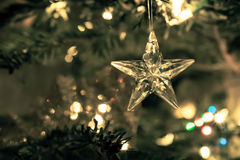 Star of glass with abstract background of holiday lights. And winter background for festive occasions Royalty Free Stock Photos