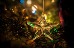 Star of glass with abstract background of holiday lights. And winter background on multicolor for festive occasions stock images