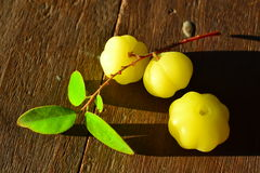 Star gooseberry. Three star gooseberry on the wooden royalty free stock images