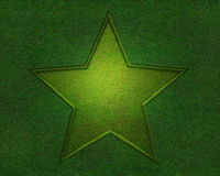 Star on green grass texture Stock Photo