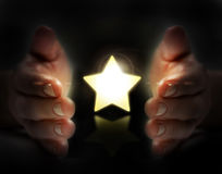 Star in hand. Means a wish Stock Photography