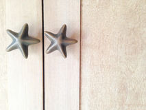 Star handles. On wood board Royalty Free Stock Photo