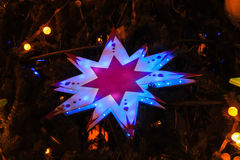 Star hanging on the Christmas tree. Big star hanging on the Christmas tree Stock Photo