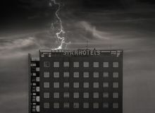 Star hotel in storm and thunder Royalty Free Stock Photography