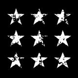 Star icons grunge texture set. Star icons with grunge texture set. Vintage retro style. Design elements. White silhouette, isolated on black background. Grungy royalty free illustration