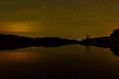 Star lake sky forest reflection Stock Images