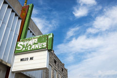 Star Lane Bowling Alley sign against a blue sky in the city of Carthage, Missouri. Carthage, Missouri, USA - July 6, 2014: Star Lane Bowling Alley sign against a Royalty Free Stock Photos