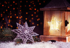 Star and lantern in bright lights Stock Photo