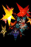 Star lanterns. Hanging lanterns in the shape of stars with paterns on them and lights inside stock photo