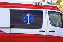 Star of Life Medical Symbol on Ambulance. Star of Life and Rod of Asclepius (Latin Aesculapius), Medical symbol of emergency, on Ambulance emergency vehicle Royalty Free Stock Images