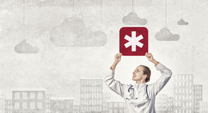 Star of life. Young female doctor holding medicine symbol in hands stock image