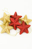 Star like christmas ornaments. Star-like christmas tree balls with, isolated Royalty Free Stock Image