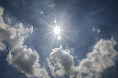 Star like Sun shining on the Blue Sky. Stock Photos