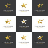Star logo set. Set of abstract golden star icons, symbols and logo templates isolated on black and white backgrounds Stock Photography
