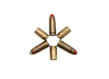 Star made of 9mm cartridges and cases isolated. Star made of 9mm Parabellum cartridges and spent cases isolated Royalty Free Stock Image