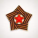 Star made of double Saint George ribbon with Red star within. Vector illustration. Stock Photos