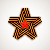 Star made of interlaced Saint George ribbon with Red star within Stock Photos