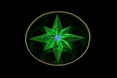 Star made of LED lights. Glowing in the night Stock Image