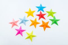 A star made of rainbow-colored paper. Festive decor starry sky. White background. Favorite hobby. Creativity with children stock photography