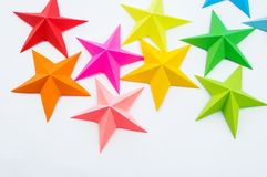 A star made of rainbow-colored paper. Festive decor starry sky. White background. Favorite hobby. Creativity with children stock photo
