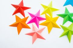 A star made of rainbow-colored paper. Festive decor starry sky. White background. Favorite hobby. Creativity with children royalty free stock photos