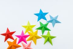 A star made of rainbow-colored paper. Festive decor starry sky. White background. Favorite hobby. Creativity with children royalty free stock image