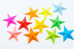 A star made of rainbow-colored paper. Festive decor starry sky. White background. Favorite hobby. Creativity with children royalty free stock images