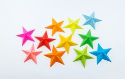 A star made of rainbow-colored paper. Festive decor starry sky. White background. Favorite hobby. Creativity with children royalty free stock photo