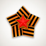 Star made of wide Saint George ribbon with Red star within. Vector illustration Stock Photos