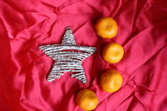 Star and mandarins on the red cloth like a symbol of flag of China Stock Photography
