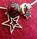 Star Moon & Fire .925 Sterling Silver & Glass Beads. Beautifully crafted beads put together in an eye catching motif stock photography