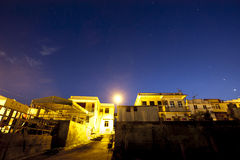 Star night in Fishing village Royalty Free Stock Photo