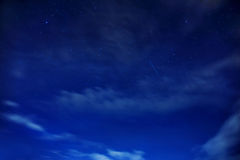 Star night sky. Star sky. Dark blue sky with light clouds and falling stars. Perseids meteor shower stock image