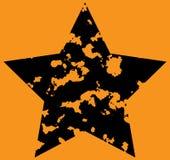 Star on orange background. Stock Photography