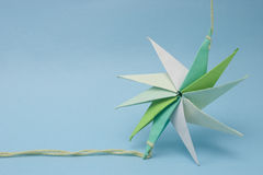 Star origami on thread Royalty Free Stock Images