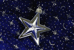 Star ornament on blue sky. With siver stars pattern Royalty Free Stock Photography