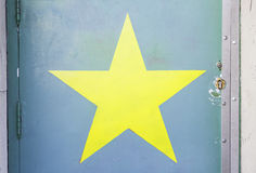 Star painted on a wall. Detail of a painting decoration Stock Image